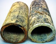 Old steel (left) and asbestos cement (right) pipes.