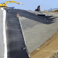 Installation of the HDPE liner by using a long arm excavator