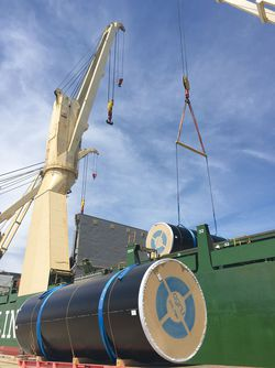 AGRU HDPE pipes loading onto a ship